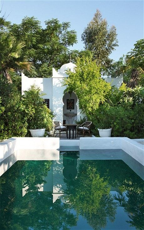 The pool, now transformed into an oriental oasis