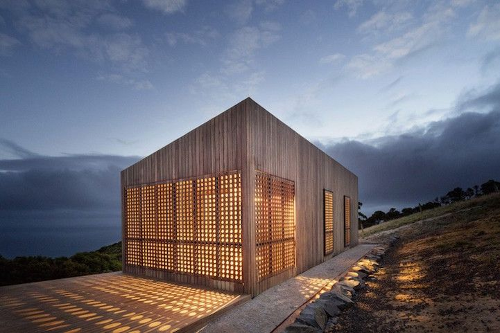 Windy Seaside Cabin Dazzles at Night with Decorative Timber Screens - My Modern Met