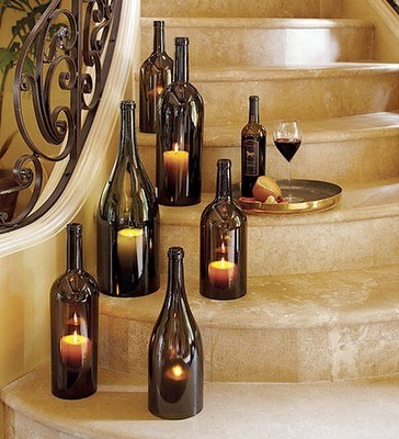 Super idea of decorations with empty bottles, candles and trays with wine/champagne glasses. Placed on the staircase