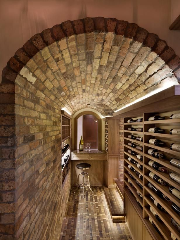 Who needs Napa or France when you've got this stunning wine room showstopper right inside your home? Barrel staves line the floor, and a quaint seating area ensures guests can spend all the time they want in this charming escape.