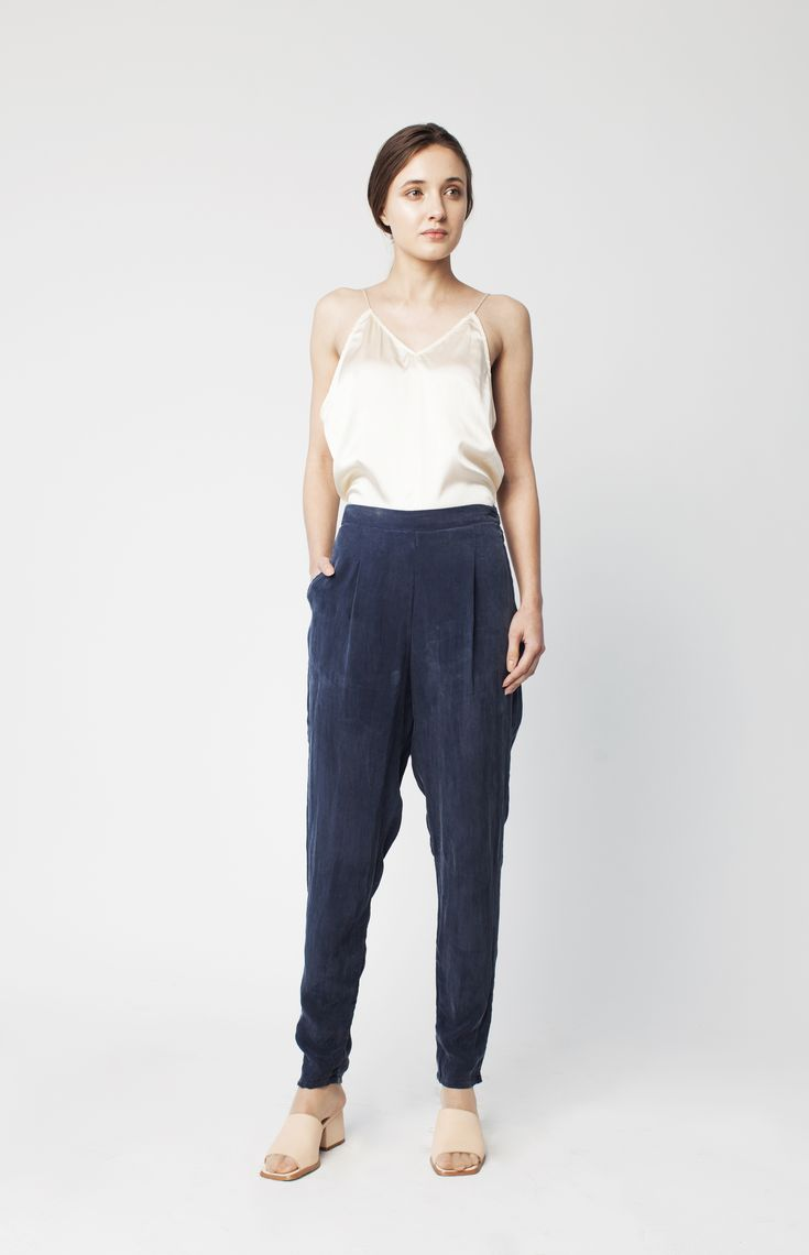 PRODUCT DETAILSHigh waisted slim trouser with elastic at back waistband. Side zipper and Italian corozo ...