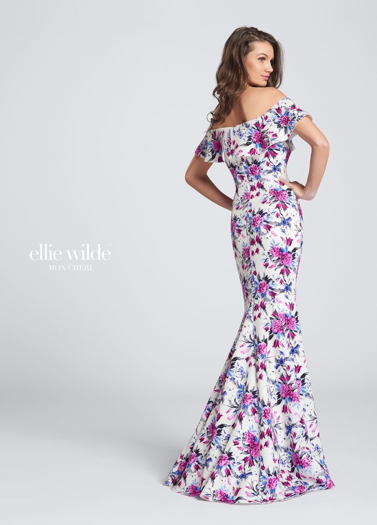 Ellie Wilde EW21755 - Long off-the-shoulder floral prom dress. Stretch novelty print fit and flare gown accented with heat set stones, wide flounce neckline, slight train. Sister dress to styles EW117150 and EW117151.