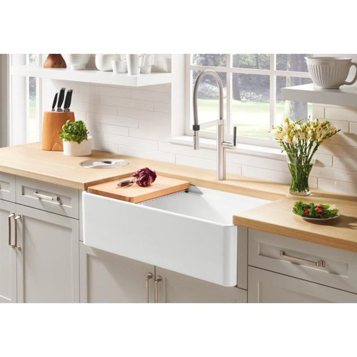 Traditional style comes up-to-date in all the right ways. Discover the beauty of the Profina apron front sink. Made of authentic fireclay and featuring an iconic farmhouse look with thin walls and an integrated accessory ledge to give it a modern feel, the Blanco Profina is durable, beautiful, and versatile. <br><br>This single bowl apron front kitchen features a unique functional ledge along the rim that allows placement of the included sliding cutting board or other accessories....