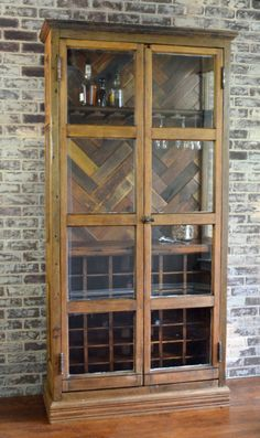 Wine storage cabinet made from architectural salvage - Glass and Wood Bar cabinet - https://secondchanceart.net/product/wine-storage-cabinet-made-from-architectural-salvage-glass-and-wood-bar-cabinet/