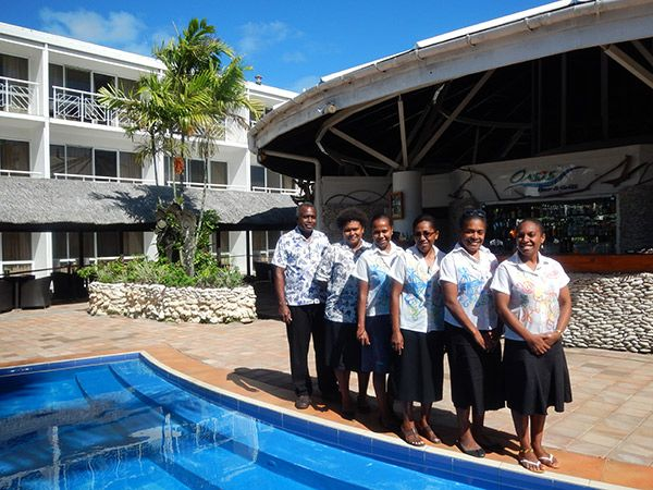 Staff of VTO get a group photo with a Manager Mr Joe Tamata. Photograph © Sebastien Bador.