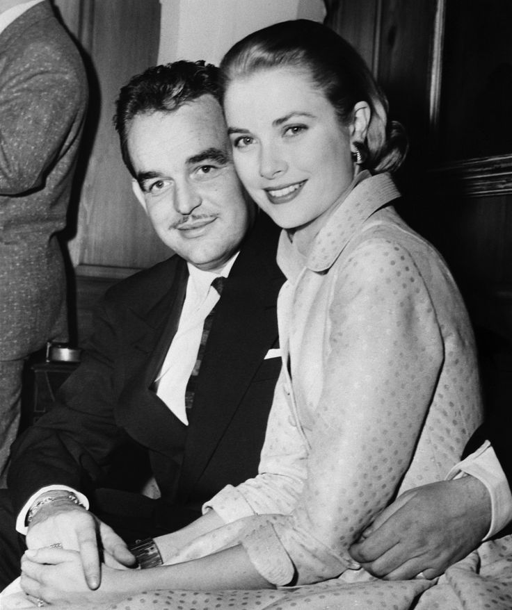 """Prince Rainier III of Monaco and lovely Grace Kelly, reigning """"Queen"""" of the American screen, pose for photographers at the home of Miss Kelly's parents after the pair's engagement was announced January 5, 1956.  The couple announced that they would be married shortly after Easter."""