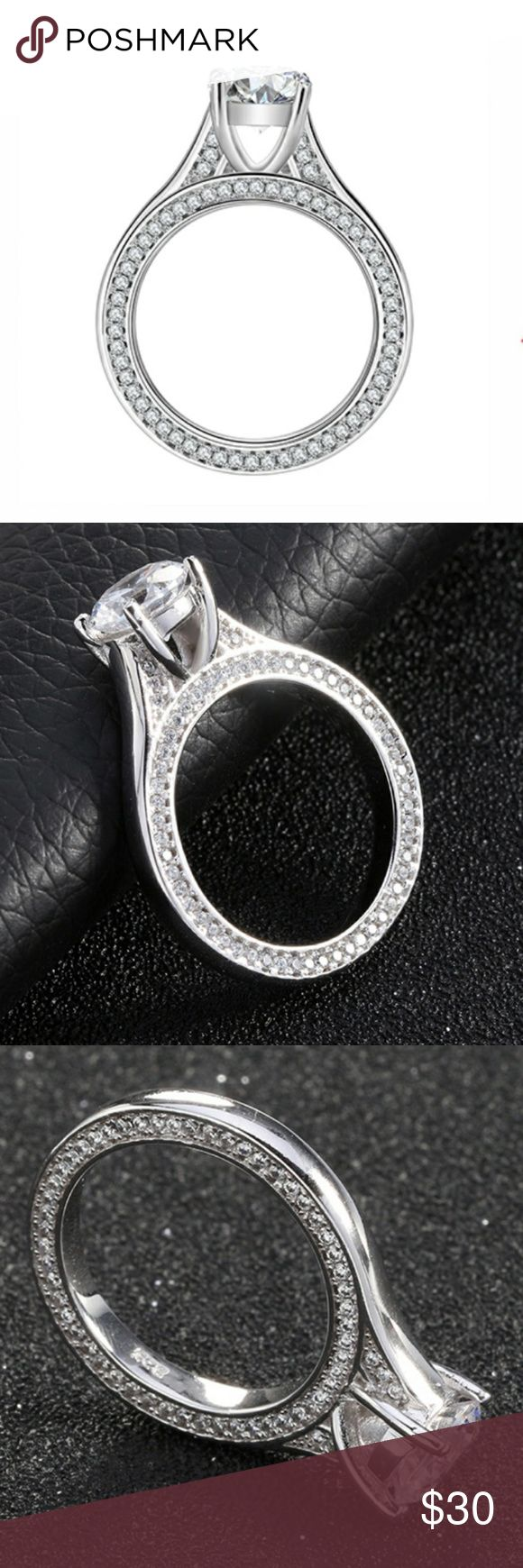NWOT Cathedral Cz Engagement Ring Size 8 A beautiful ring that will surely turn heads. Eternity cz's along both sides of the ring. Center stone is approximately 2 karats. White brass. Jewelry