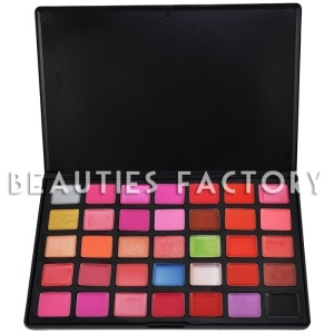 """100% Brand new in retail package  35 Colors Lip Gloss Palette - """"32 Matte Colors + 3 Shimmer Colors""""  Brand : Beauties Factory  Color Version : #1 (GORGEOUS LADY)  35 Colors include : Glittery , Glossy , Pure  Easily create clear and brilliant Sexy lip makeup finish  Suitable for causal makeup and party makeup  Each Color Size : 2.5cm x 2cm  Case Size : 23.5cm x 15.5cm x 1cm  Free gift : 1 piece of false eyelashes for sample try  Price: £14.49  Ingredients : Castor Oil, Isopropyl Palmitate"""