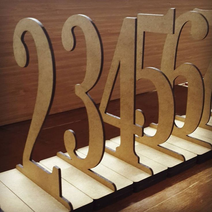 Simple wooden table numbers ready for delivery.