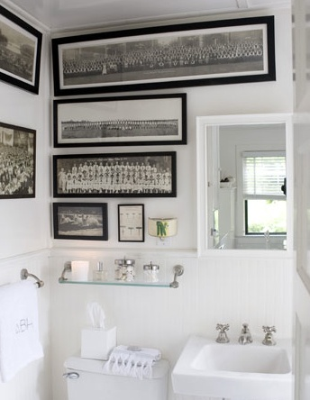 White bathroom with black and white photos