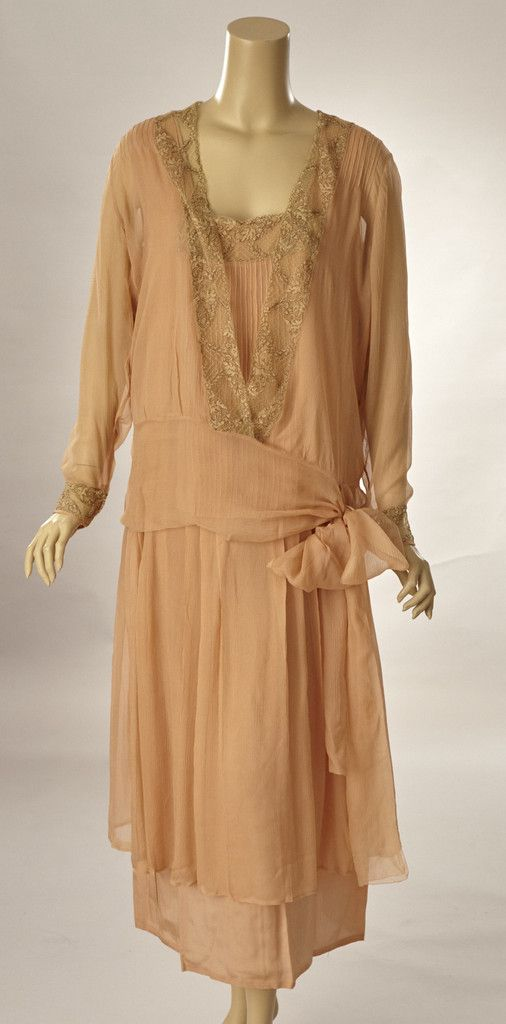 1920s Beautiful peach silk Georgette dress with matching over blouse. The sleeveless dress is drop-waisted and has a deep scoop neckline is front bordered with lace. The lace is ivory with the pattern outlined in brown embroidery floss.