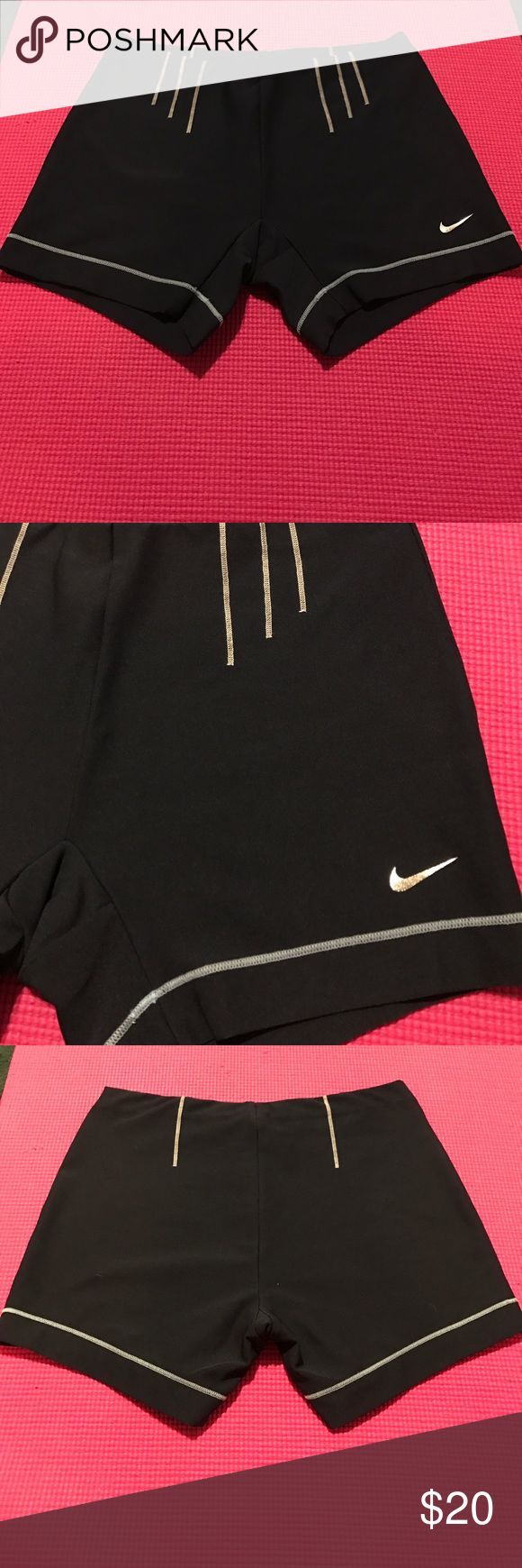 Women's Nike shorts Women's Nike shorts spandex dri fit size medium8-10. It's hard to see the colors in the pictures! These shorts are a navy blue the stitching at the top is white and the stitching at bottom is a light blue with a metallic silver swoosh! Super cute and worn once! Nike Shorts