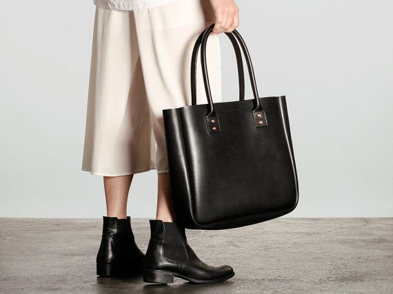 This is our Large Leather Tote Bag. A comfortable large carryall for everyday life, stylish lunches, weekend adventures, or daily errands around town. A classic landscape silhouette with soft and comfortable straps for carrying anything and everything you want. Sturdy, strong construction with distinct detailing and craftsmanship, plus simple storage options to suit your lifestyle. One large compartment with one continuous gusset. Made with Australian Full Grain Cow Leather, Solid Copper…