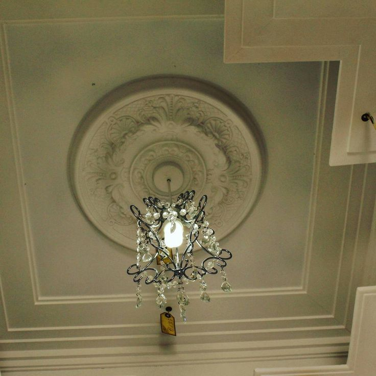 One small ceiling rose for limited size estates.