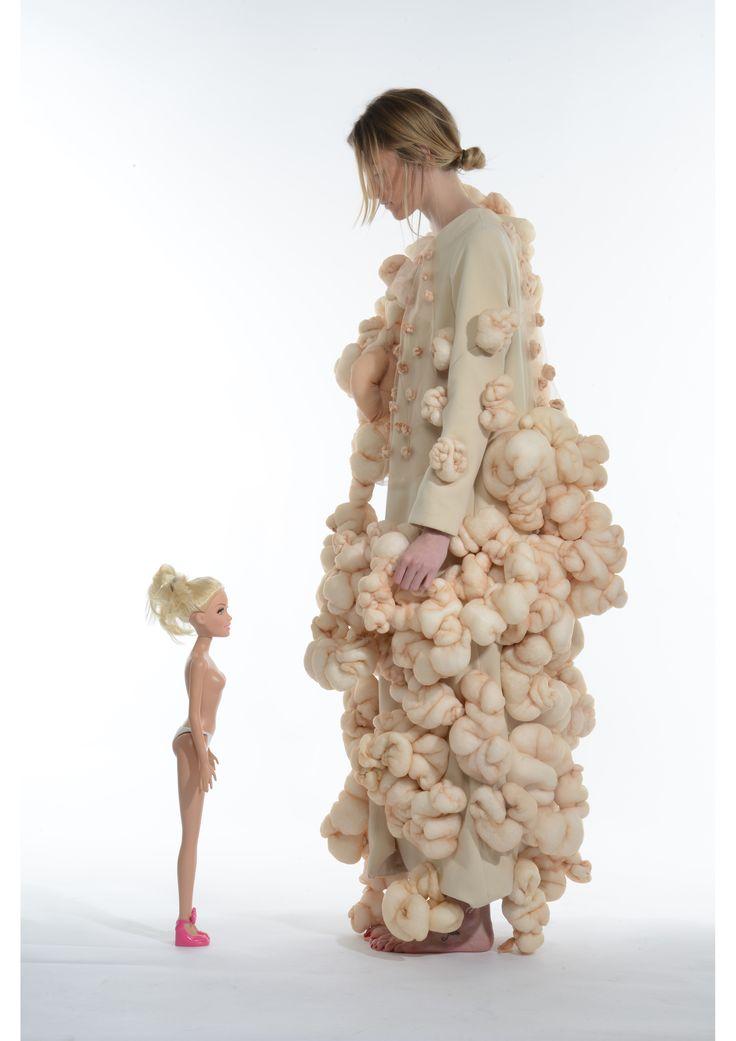 TONI GUNNS, UNIVERSITY OF CENTRAL LANCASHIRE - I have used 3D textile sculpting techniques to build up 'lumps and bumps' creating a surface design to alter and disproportionate the body into a more authentic but exaggerated form. Contrasting against symmetrical proportions and straight lines the silhouettes become less than perfect conventionally.