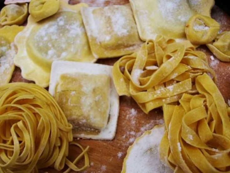 10 things you didn't know about bolognese sauce...Fresh flour-dusted Italian pasta, tagliatelle is on the right. Image by Chris Rubberdragon / CC BY-SA 2.0