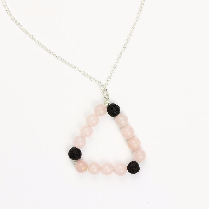 Love Triangle aromatherapy necklace. Made with rose quartz and lava stone. Can be used to diffuse essential oils!