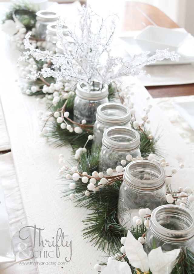 Tablescape idea for Christmas dining table. Wood planks and mason jar tea lights.