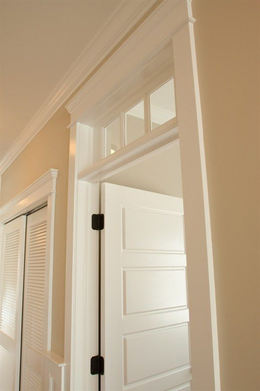 love transom over the door.. adds character. Want this for all my bedrooms and bathrooms to add light