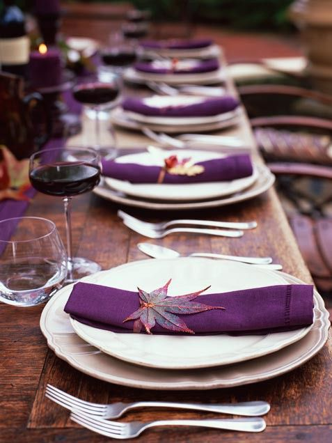 I really like those leaves because they're purple and red?orange? and would go great with a fall wedding. :D