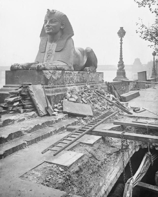 Rubble surrounds the Sphinx on London's Victoria Embankment, following an air raid on the night of 4 - 5 September 1917. The Sphinx was damaged in several places by fragments of flying debris, but the main damaged caused by the 50 kilogram bomb can be seen in the foreground. Gas and water mains as well as electricity cables were affected.