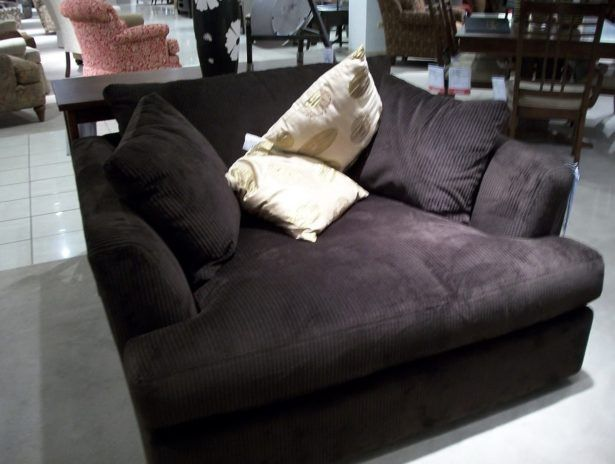 big comfy oversized armchairs where you can snuggle up with a blanket and pillows