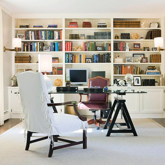 Give your office shelves an organized feel. More tips for arranging bookshelves: http://www.bhg.com/decorating/storage/shelves/get-picture-perfect-bookshelves/?socsrc=bhgpin082613office=5