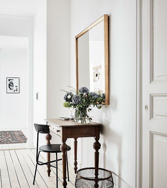 Create a desk anywhere you have a blank wall with a smaller side table and a chair tucked underneath.
