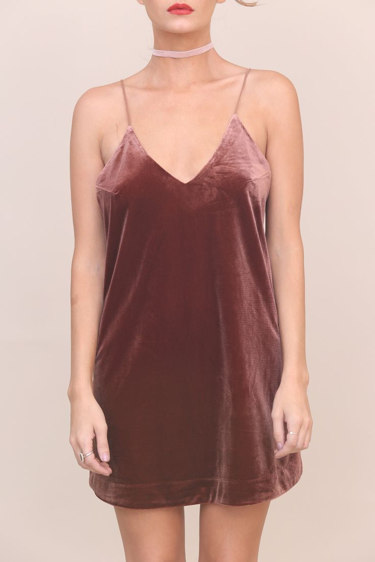 Velvet slip dress. V-neckline. Fully lined. Style #: CD-7329 Material: Polyester/Spandex Color: Brown Model is wearing a small