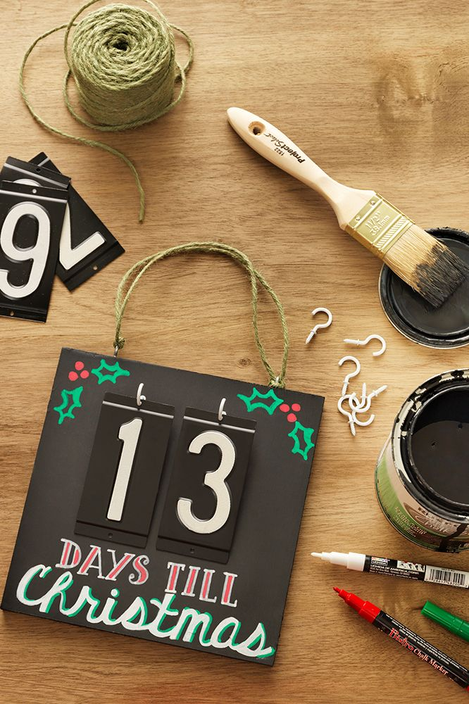 Use house numbers for a Christmas countdown calendar you can actually flip. Click through to see the supplies from The Home Depot we used to make it.