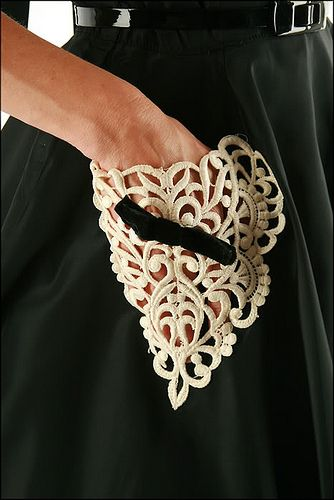 Nice idea for the use of small pieces of old lace.  Scraps can be stitched together to give strength & placement design.