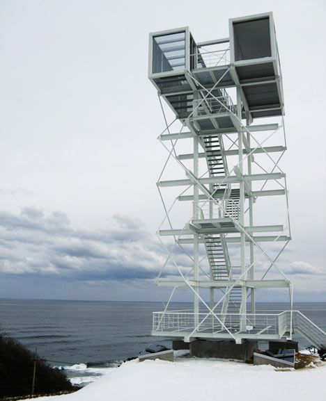 Two shipping containers provide a sea-facing observation deck atop this tower in South Korea by Portuguese artist Didier Faustino