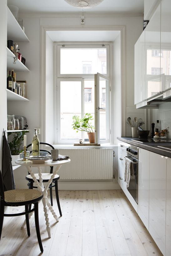 I love galley kitchens when done this well. It looks so inviting and would discourage accumulating too much stuff!