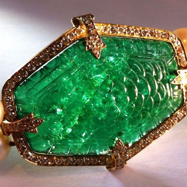 An Indian 19th century double sided carved emerald plaque of approximately 60 carats