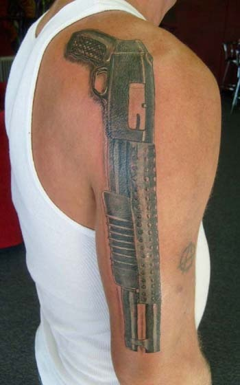 Shotgun Tattoo arm shoulder www.alteredrealitytattoo.com