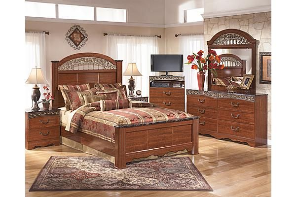"""The Fairbrooks Estate Poster Bedroom Set from Ashley Furniture HomeStore (AFHS.com). The """"Fairbrooks Estate"""" bedroom collection features warm finishes and ornate detailing to create a furniture collection that is sure to enhance your bedroom decor with an inviting traditional design."""