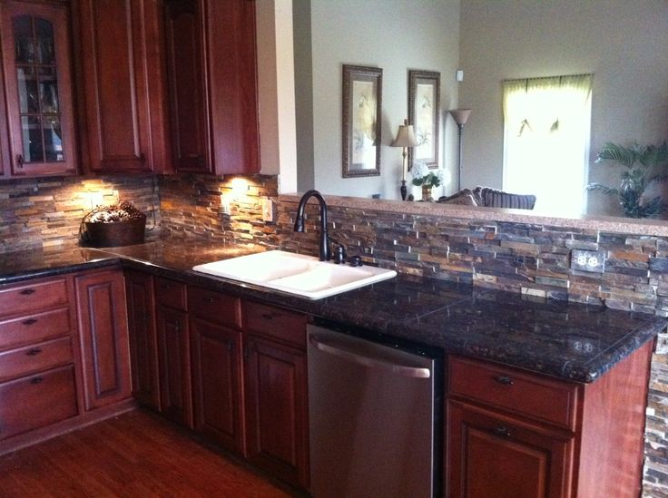 stone backsplash after install grainite tile countertop and stone
