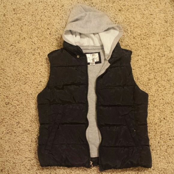 Black Puffer Vest w/ Detachable Gray Hood Detachable hood! Pockets! Fits more like an X-Small! LIKE NEW condition! Prospirit Athletic Gear  Jackets & Coats Vests