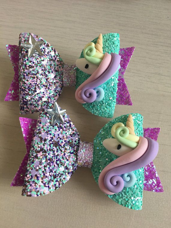 Lovely glitter fabric bow with clay and star embellishment on alligator clip