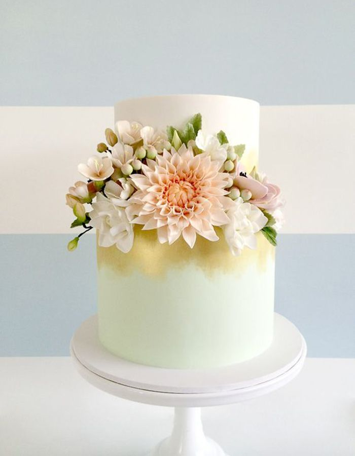 21 Two-Tiered Cakes That Prove Bigger Isn't Always Better - flower two tiered wedding cake with mint and gold airbrushing