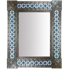 """The Mexican tin mirror with inlaid Talavera tiles makes a bright and beautiful addition to any southwest, Santa Fe, or Spanish colonial style bathroom, entryway, or bedroom. Measures: 25"""" x 31"""""""