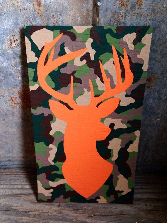 """Hand crafted and all hand painted wooden sign - bright orange OR pink buck silhouette on camo background - Approximately 9.5""""x16.5"""" on Etsy, $32.00"""