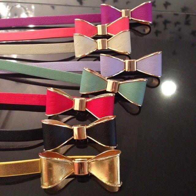 This adorable bow belt features a tiny bow with golden trim. Its also is adjustable and can fit many sizes comfortably.