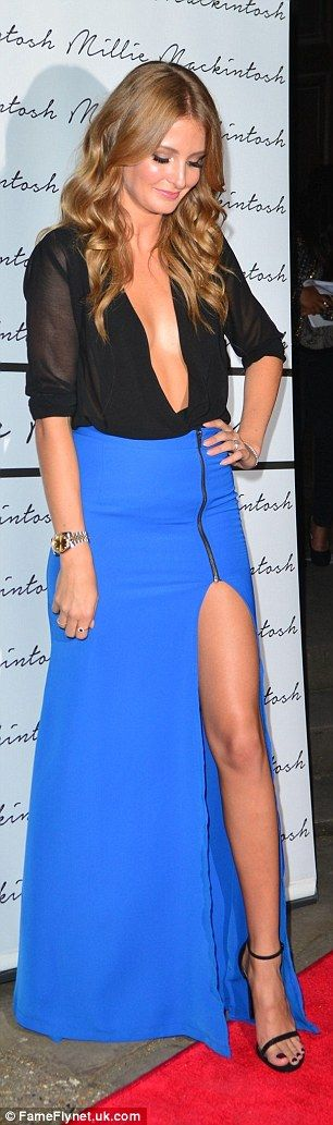 Oooh la la: For her second look, also taken from her collection, Millie wore a full length cobalt skirt which featured a thigh high split with a black plunging shirt and heeled sandals