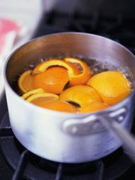 I had an orange that I was about to toss - looked this up on pinterest - and found this: boil orange rinds or lemon+rosemary for an easy living room scent.  It made my whole house smell wonderful!  :-)