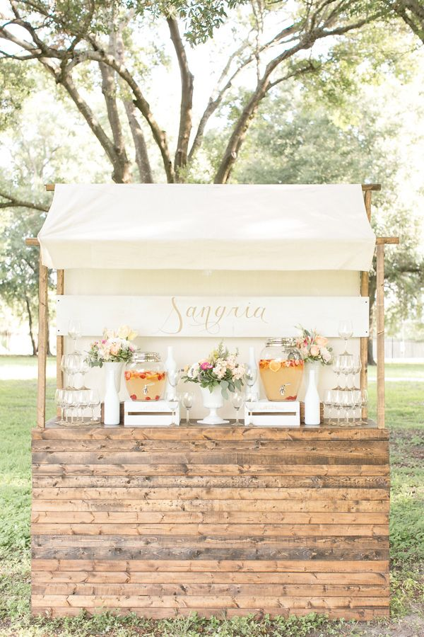 Sangria drink stand, photo by Amalie Orrange Photography http://ruffledblog.com/sangria-inspired-wedding-ideas #weddingideas #drinkbar