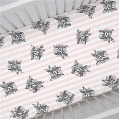 "Crib Fitted Sheet in and Pink and Gray Floral Stripe by Carousel Designs.  Our fitted crib sheets feature deep pockets and have elastic all the way around the edges to hug mattresses securely. Fits standard crib mattresses, measuring approximately 28"" x 52""."