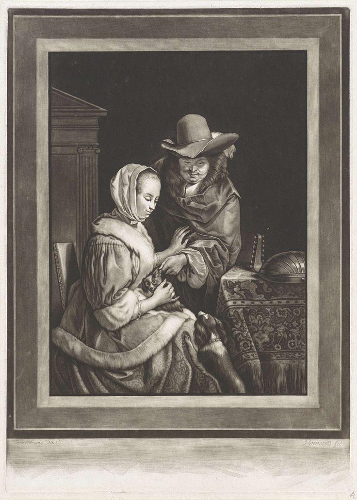 John Greenwood | Een man en een vrouw met twee honden, John Greenwood, 1739 - 1792 | Interieur met een man die een hondje aait dat op de schoot van een elegant geklede vrouw zit. Een tweede hondje staat tegen de rokken van de vrouw. Op de tafel ligt een luit.