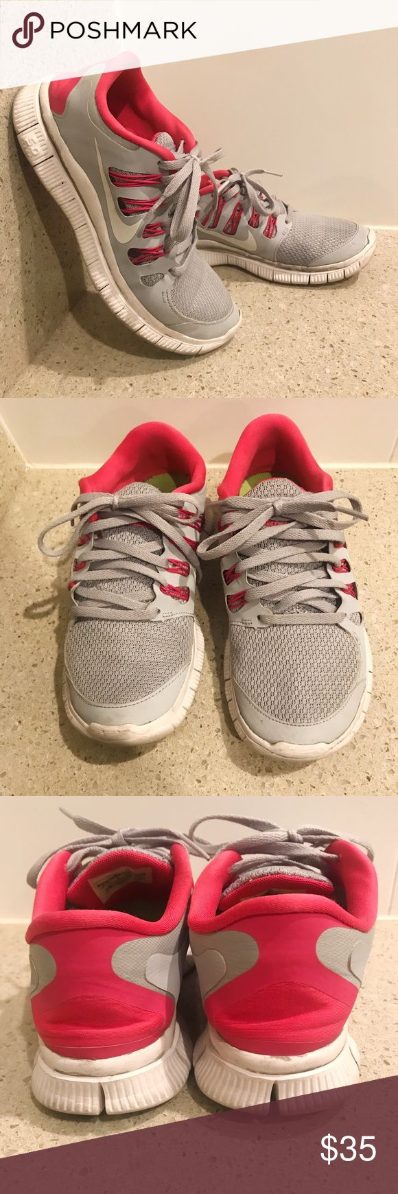 Nike frees 5.0+ running shoes Nike frees 5.0+ running shoes • size 6.5 • true to size • color gray & pink • used but still very comfortable • some gray paint appeared on the bottom of shoe (picture shown above)  💗 Nike Shoes Athletic Shoes