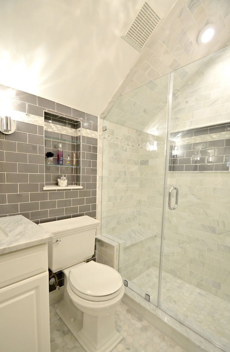 Bathroom Remodel Features Glass Tile Wall And Carrara